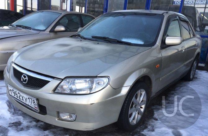 подержанный авто Mazda 323 2002 года